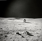 Astronaut Edgar D. Mitchell, lunar module pilot, photographed this sweeping view showing fellow Moon-explorer astronaut Alan B. Shepard Jr., mission commander, and the Apollo 14 Lunar Module (LM). A small cluster of rocks and a few prints made by the lunar overshoes of Mitchell are in the foreground. Mitchell was standing in the boulder field, located just north by northwest of the LM, when he took this picture during the second Apollo 14 extravehicular activity (EVA-2), on February 6, 1971. While astronaut Stuart A. Roosa, command module pilot, remained with the Command and Service Modules (CSM) in lunar orbit, Shepard and Mitchell descended in the LM to explore the Moon.<br /> Mandatory Credit: Edgar D. Mitchell / NASA via CNP