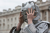 A Sci-fi fan gets into a Cyberman costume. About 100 Science Fiction fans dressed up as their favourite characters and gathered in the courtyard of Somerset House to head off for the 4th Sci-Fi London Annual Costume Parade. The parade was organised by Sci-Fi London 14, the London International Festival of Science Fiction and Fantastic Film. The film festival runs until 4 May 2014.