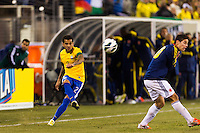 Daniel Alves (2) of Brazil crosses the ball. Brazil (BRA) and Colombia (COL) played to a 1-1 tie during international friendly at MetLife Stadium in East Rutherford, NJ, on November 14, 2012.