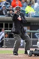 Home plate umpire Chris Ward makes a call during a game between the Syracuse Chiefs and Rochester Red Wings at Alliance Bank Stadium on April 5, 2012 in Syracuse, New York.  Rochester defeated Syracuse 7-4.  (Mike Janes/Four Seam Images)