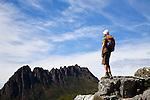 A hiker looks toward Cradle Mountain.  Cradle Mountain-Lake St Clair National Park, Tasmania, AUSTRALIA