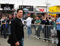 Feb 22, 2009; Fontana, CA, USA; Former football player Jason Sehorn tours the garage prior to the Auto Club 500 at Auto Club Speedway. Mandatory Credit: Mark J. Rebilas-