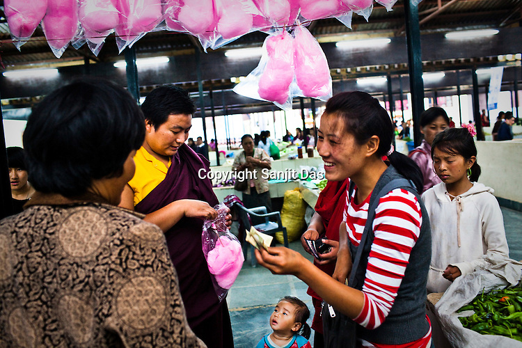 Local Bhutanese buy candy floss in a local market in Thimphu, Bhutan. Photo: Sanjit Das/Panos