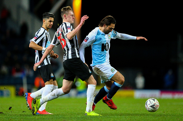 Blackburn Rovers' Bradley Dack gets away from Newcastle United's Sean Longstaff and Ayoze Perez<br /> <br /> Photographer Alex Dodd/CameraSport<br /> <br /> Emirates FA Cup Third Round Replay - Blackburn Rovers v Newcastle United - Tuesday 15th January 2019 - Ewood Park - Blackburn<br />  <br /> World Copyright © 2019 CameraSport. All rights reserved. 43 Linden Ave. Countesthorpe. Leicester. England. LE8 5PG - Tel: +44 (0) 116 277 4147 - admin@camerasport.com - www.camerasport.com