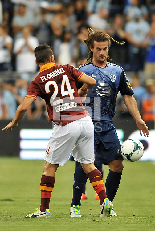 Sporting Park, Kansas City, Kansas, July 31 2013:<br /> Kyle Beckerman (23) midfield MLS All-Stars , llessandro Florenzi (24) midfield AS Roma.<br /> MLS All-Stars were defeated 3-1 by AS Roma at Sporting Park, Kansas City, KS in the 2013 AT & T All-Star game.