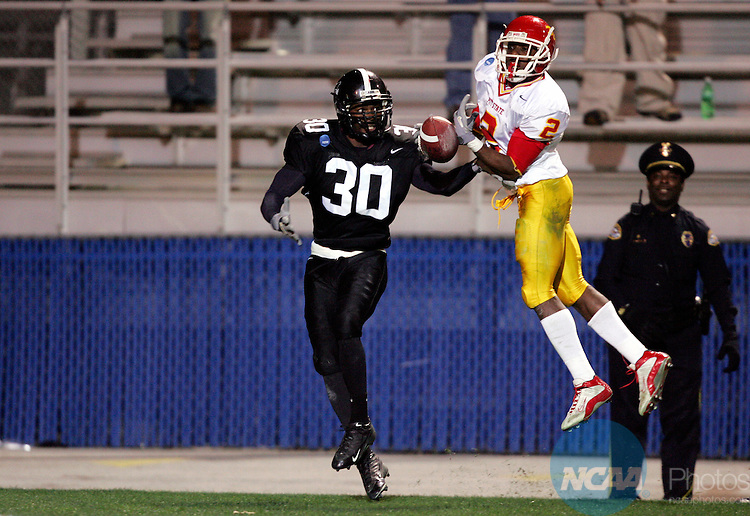 11 DEC 2004:  Cornerback Terrence Bell (30) of Valdosta State University breaks up a pass intended for wide receiver Jermaine Carpenter (2) of Pittsburg State University during the Division II Men's Football Championship held at Braly Municipal Stadium in Florence, AL.  Valdosta State defeated Pittsburg State 36-31 for the national title.  Jamie Schwaberow/NCAA Photos