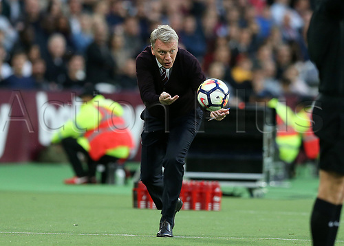 10th May 2018, London Stadium, London, England; EPL Premier League football, West Ham United versus Manchester United; West Ham United Manager David Moyes throwing the ball back to Marko Arnautovic of West Ham United  from the touchline