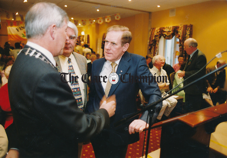 Ennis UDC chairman, Peter Considine chatting with Liam Jones of the Fleadh Nua committee and Labhras Ó Murchu, ard stiurtheoir CCE at the official opening of the Fleadh Nua in the Temple Gate hotel - date unknown (1998-2000). Photograph by John Kelly