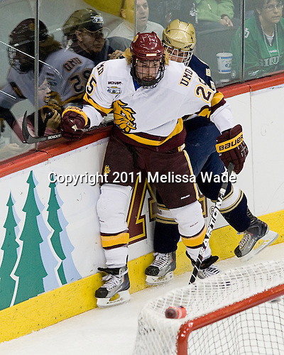 Justin Faulk (Duluth - 25), Ben Ryan (Notre Dame - 19) - The University of Minnesota-Duluth defeated the University of Notre Dame Fighting Irish 4-3 in their 2011 Frozen Four Semi-Final on Thursday, April 7, 2011, at the Xcel Energy Center in St. Paul, Minnesota.