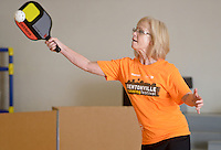 NWA Democrat-Gazette/BEN GOFF @NWABENGOFF<br /> Pat Bantz of Bentonville returns the ball on Monday Nov. 16, 2015 during a game of pickleball at the City of Rogers Senior Wellness Center.