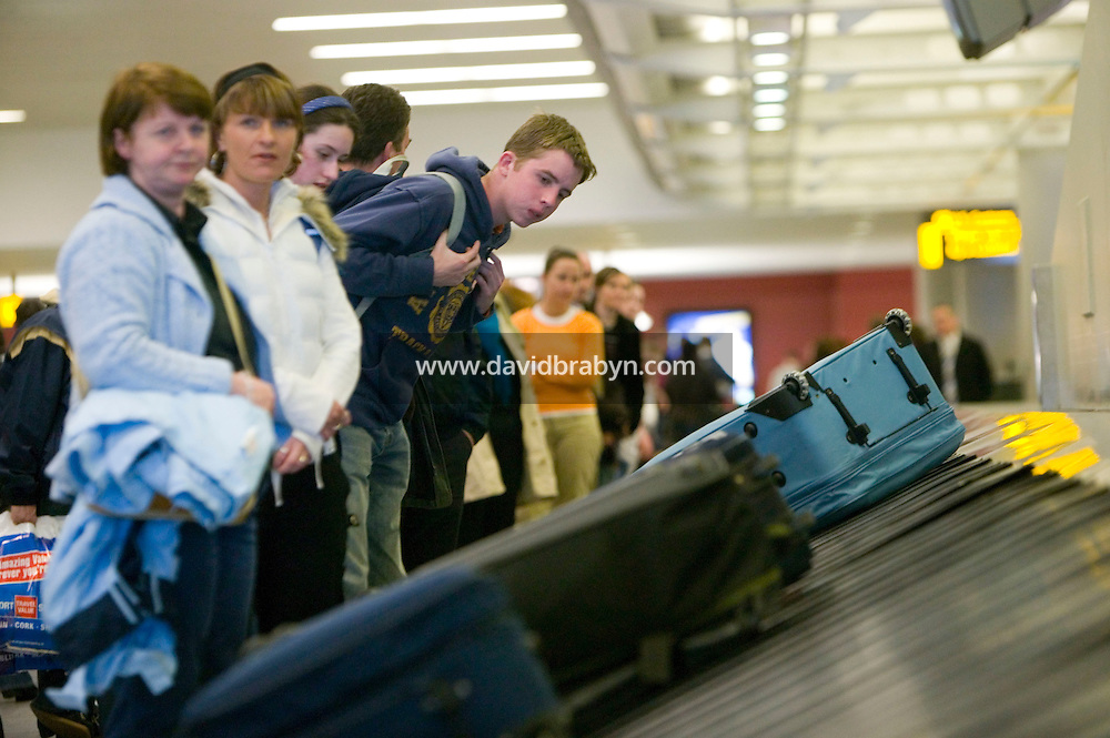 11 April 2006 - New York City, NY - Arriving visitors to the US wait for luggage at the luggage claim belt in Terminal 4 at JFK airport in the Queens borough of New York City, USA, 11 April 2006.