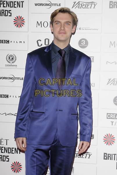 Dan Stevens.The 14th Moet British Independent Film Awards 2011, Old Billingsgate, London, England..December 4th, 2011.half length purple suit.CAP/CAN.©Can Nguyen/Capital Pictures.
