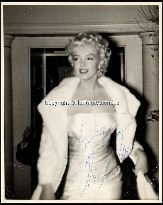 BNPS.co.uk (01202 558833)<br /> Pic: HeritageAuctions/BNPS<br /> <br /> Signed photo of Marilyn Monroe, circa 1955.<br /> <br /> A trove of rare and never-seen-before snapshots of Hollywood legend Marilyn Monroe have emerged for sale from the collection of a superfan who spent years following the star.<br /> <br /> The collection of 183 pictures of the pin up were all taken around New York in the mid-1950s by superfan James Collins, a teenager who was a member of the 'Monroe 6'.<br /> <br /> The youngsters were such avid fans Monroe ended up knowing them all by name and allowed them special access to her to take countless photos and signed numerous autographs.<br /> <br /> Collins is now auctioning the 183 photos in 18 lots through Heritage Auctions in Dallas, Texas.