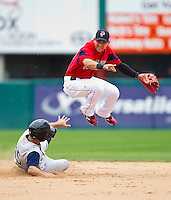 Shortstop Jose Iglesias #10 of the Pawtucket Red Sox completes a double play as Jordan Danks #15 of the Charlotte Knights slides into second base at McCoy Stadium on June 12, 2011 in Pawtucket, Rhode Island.  The Red Sox defeated the Knights 2-1.    Photo by Brian Westerholt / Four Seam Images