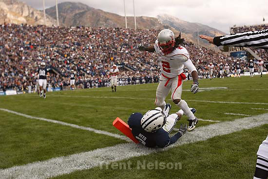 Provo - New Mexico's DeAndre Wright leaps over BYU WR Michael Reed (3), after Reed missed a reception. BYU vs. New Mexico college football at LaVell Edwards Stadium, Saturday, October 11, 2008.
