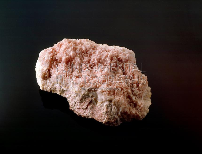 RHODOCHROSITE - Ore of MANGANESE(MnCO3)<br /> A minor ore of manganese, an ornamental and semi-precious gemstone
