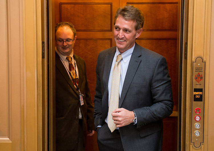 UNITED STATES - MARCH 7: Sen. Jeff Flake, R-Ariz., arrives for the Senate Republicans' policy lunch on Thursday, March 7, 2013. (Photo By Bill Clark/CQ Roll Call)