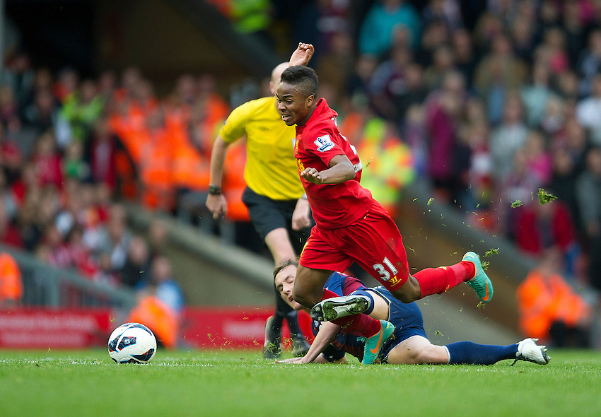 Liverpool's Raheem Sterling is fouled by Stoke City's Dean Whitehead ..Football - Barclays Premiership - Liverpool v Stoke City - Sunday 7th October 2012 - Anfield - Liverpool..