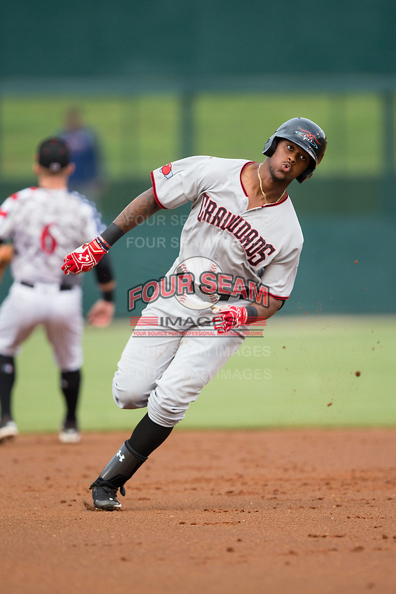 Ti'Quan Forbes (10) of the Hickory Crawdads hustles towards third base against the Kannapolis Intimidators at Kannapolis Intimidators Stadium on April 21, 2017 in Kannapolis, North Carolina.  (Brian Westerholt/Four Seam Images)