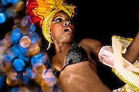 A Cuban girl dances a sexually provocative salsa during the Carnival in Santiago de Cuba, Cuba, 26 July 2008. Carnival in Santiago de Cuba is a large public celebration which is held - contrary to the other Latin American carnivals - in the summer. The carnival tradition dates back to the 17th century when the Spanish festival of Santiago (St. James) was mixed with street dancing parades of the Black African slaves. Nowadays comparsas, carnival groups of dancers and musicians, flow in the streets and perform popular music like salsa, rumba or reggaeton. In spite of the general lack of funds in Cuba (most of the festival costumes and floats are home-made) the Carnival is very lively and hot show with huge participation of the people of Santiago de Cuba.