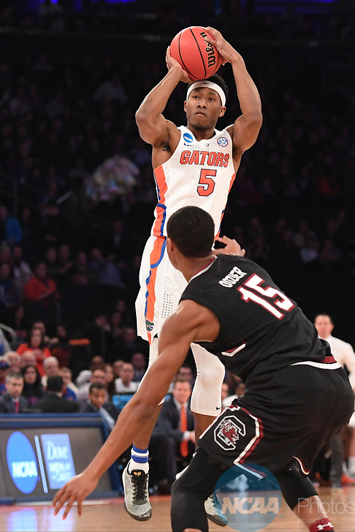 NEW YORK, NY - MARCH 26: KeVaughn Allen #5 of the Florida Gators is guarded by PJ Dozier #15 of the South Carolina Gamecocks during the 2017 NCAA Men's Basketball Tournament held at Madison Square Garden on March 26, 2017 in New York City. (Photo by Justin Tafoya/NCAA Photos via Getty Images)