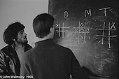 "Playing ""Noughts & Crosses"" with the Science teacher, Summerhill school, Leiston, Suffolk, UK. 1968."