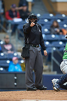 Home plate umpire Mike Wiseman makes a strike call during the International League game between the Gwinnett Braves and the Durham Bulls at Durham Bulls Athletic Park on April 20, 2019 in Durham, North Carolina. The Bulls defeated the Braves 11-3 in game one of a double-header. (Brian Westerholt/Four Seam Images)