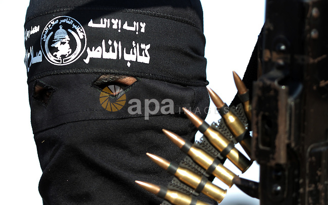 Palestinian militants from the Popular Resistance Movement participate in a training session in the southern Gaza Strip town of Khan Younis on Sept.30,2011. Israel on Tuesday approved construction of 1,100 homes for Jews on the annexed land in the West Bank, a move that could complicate international efforts to renew peace talks and defuse a crisis over a Palestinian statehood bid at the United Nations. Photo by Abed Rahim Khatib