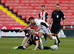Caolan Lavery of Sheffield Utd brought down by Joe Edwards of Walsall during the Carabao Cup First Round match at Bramall Lane Stadium, Sheffield. Picture date: August 9th 2017. Pic credit should read: Simon Bellis/Sportimage