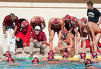 STANFORD, CA - October 9, 2010: Head Coach John Vargas talk to the team during a water polo game against USC in Stanford, California. Stanford beat USC 5-3.