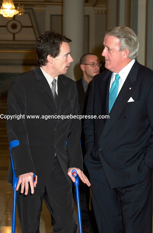 Montreal, April 4rd 2001<br /> Quebecor President and CEO and Vice-Chairman of the Board of Quebecor World ; Pierre-Karl Peladeau (left) on crutches after a skiing accident in Europe speak with Sun Media Corp Chairman of the Board ;  The Right Honorable Brian Mulroney after the<br /> Quebecor World annual meeting, April 4th 2001, in Montreal, CANADA<br /> <br /> Since the `` Merger of equals `` between Quebecor Printing and World Color, the company operating margin reached a record high of 11.1 % for the year ; revenues increased by 32 % to 6.5 billion US $ ; operating income increased by 53 % to 724.8 Million US $  and net income increased by 43 % to 293.4 Million US $, or 1,93 US $ per share.<br /> <br /> Quebecor World is now the largest and strongest performing entity in the printing field<br /> Photo by Pierre Roussel  / Liaison<br /> NOTE :  D-1 photo uncorrected