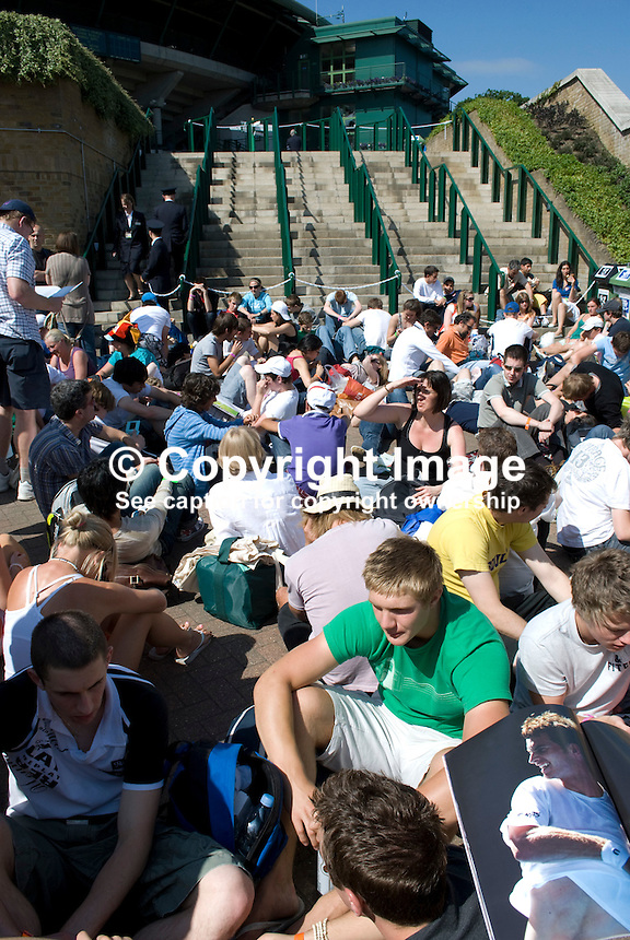 Tennis enthusiasts sit at the bottom of the steps waiting for admission to start at the Wimbledon Tennis Champtionships, London, UK. 200906232579..Copyright Image from Victor Patterson, 54 Dorchester Park, Belfast, UK, BT9 6RJ..Tel: +44 28 9066 1296.Mob: +44 7802 353836.Voicemail +44 20 8816 7153.Skype: victorpattersonbelfast.Email: victorpatterson@mac.com.Email: victorpatterson@ireland.com (back-up)..IMPORTANT: If you wish to use this image or any other of my images please go to www.victorpatterson.com and click on the Terms & Conditions. Then contact me by email or phone with the reference number(s) of the image(s) concerned.