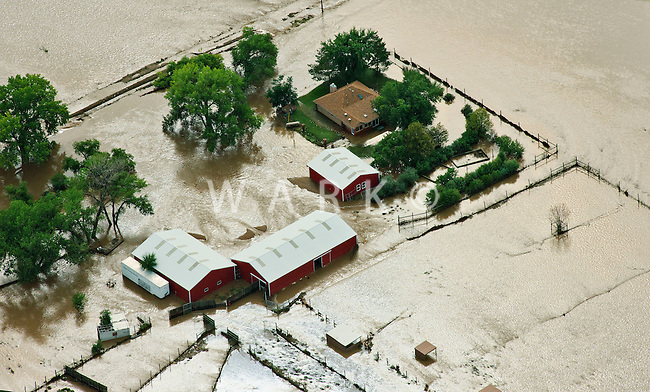Flooding along South Platte River in Weld County, Colorado near Greeley.  Farmhouse