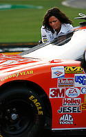 May 27, 2006; Charlotte, NC, USA; Nascar Nextel Cup series official Brienne Davis inspects the car of Tony Stewart during qualifying for the Coca Cola 600 at Lowes Motor Speedway. Mandatory Credit: Mark J. Rebilas-US PRESSWIRE]
