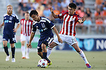 14 June 2014: Carolina's Cesar Elizondo (CRC) (7) is defended by Chivas USA's Carlos Alvarez (20). The Carolina RailHawks of the North American Soccer League played Chivas USA of Major League Soccer at WakeMed Stadium in Cary, North Carolina in the fourth round of the 2014 Lamar Hunt U.S. Open Cup soccer tournament. The RailHawks advanced by winning a penalty kick shootout 3-2 after the game had ended in a 1-1 tie after overtime.