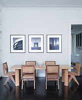 In the family dining room the walls are finished in marmorino plaster and the flooring is dark wood parquet. The table is by Perriand and the chairs are by Jeanneret.