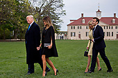 U.S. President Donald Trump, from left, U.S. First Lady Melania Trump, Brigitte Macron, France's first lady, and Emmanuel Macron, France's president, walk outside the Mansion at the Mount Vernon estate of first U.S. President George Washington in Mount Vernon, Virginia, U.S., on Monday, April 23, 2018. As Macron arrives for the first state visit of Trump's presidency, the U.S. leader is threatening to upend the global trading system with tariffs on China, maybe Europe too. <br /> Credit: Andrew Harrer / Pool via CNP