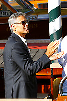 VENICE, ITALY - SEPTEMBER 01: George Clooney is chauffeured by Alessandro Greco when leaving the Hotel Excelsior after giving interviews during the 74th Venice Film Festival on September 1, 2017 in Venice, Italy.  Credit: John Rasimus/MediaPunch ***FRANCE, SWEDEN, NORWAY, DENARK, FINLAND, USA, CZECH REPUBLIC, SOUTH AMERICA ONLY***