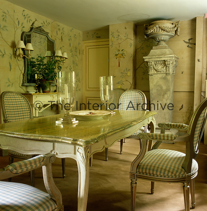 A majestic scale is brought to the small dining room with the introduction of an 18th century French column and a garden urn