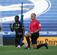 Manchester City's Benjamin Mendy (left) takes the knee for BLM<br /> <br /> Photographer David Horton/CameraSport<br /> <br /> The Premier League - Brighton & Hove Albion v Manchester City - Saturday 11th July 2020 - The Amex Stadium - Brighton<br /> <br /> World Copyright © 2020 CameraSport. All rights reserved. 43 Linden Ave. Countesthorpe. Leicester. England. LE8 5PG - Tel: +44 (0) 116 277 4147 - admin@camerasport.com - www.camerasport.com