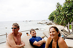 Singaporean expatriates and owners of Nikoi Island Resort, (L-R) David Taylor and Betina Brown, and her son, Theo, center, enjoy the afternoon by the pool and the sea, on Sunday, April 18, 2010.