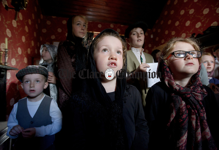 Tadhg Bermingham, Eve Grogan and Sarah Mc Gee explore the Parlour during a cultural visit to The Rambling House in Kilmurry Mc Mahon by pupils of Labasheeda National School. Photograph by John Kelly.