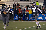 Nevada quarterback Carson Strong (12) pitches the ball to running back Toa Taua (35) against New Mexico in the second half of an NCAA college football game in Reno, Nev., Saturday, Nov. 2, 2019. (AP Photo/Tom R. Smedes)