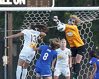 Scary masked Boston Breakers goalkeeper Alyssa Naeher (1) punches out a crossed ball. In a National Women's Soccer League (NWSL) match, Boston Breakers (blue) tied Western New York Flash (white), 2-2, at Dilboy Stadium on August 3, 2013.