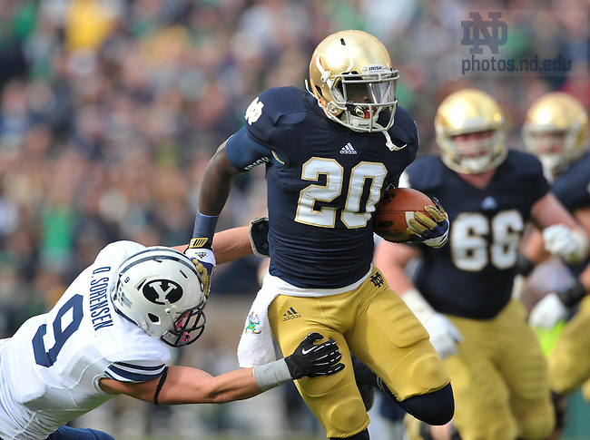 Oct. 20, 2012; Running back Cierre Wood gets past BYU defensive back Daniel Sorensen...Photo by Matt Cashore.