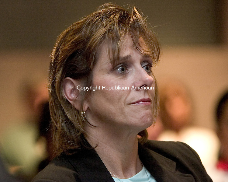 HARTFORD, CT. 29 August 2008-082908SV07--Lorraine Shea, Executive Director of the heart center, listens to public comment about extending the Heart Center of Greater Waterbury's three-year operating permit an additional six months during a public hearing of the Office of Health Care Access at the Legislative Office Building in Hartford Friday.<br /> Steven Valenti Republican-American
