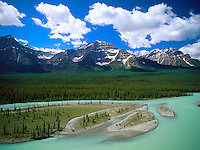 Art in Nature 9607-0116 - Landscape of mountains, sky and clouds, featuring the milky-turquoise waters of the Athabaska River in Jasper National Park. Alberta, Canada.