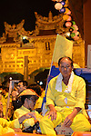 Donggang, Taiwan -- Taoist worshiper taking a rest after final preparations are made for the King Boat's last voyage.