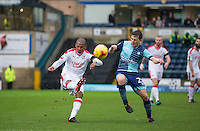 Lewis Young of Crawley Town clears from Dominic Gape of Wycombe Wanderers during the Sky Bet League 2 match between Wycombe Wanderers and Crawley Town at Adams Park, High Wycombe, England on 25 February 2017. Photo by Andy Rowland / PRiME Media Images.