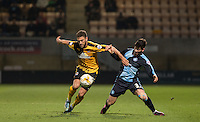 Ben Williamson of Cambridge United holds off Joe Jacobson of Wycombe Wanderers during the Sky Bet League 2 match between Cambridge United and Wycombe Wanderers at the R Costings Abbey Stadium, Cambridge, England on 1 March 2016. Photo by Andy Rowland / PRiME Media Images.